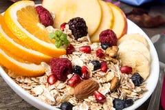 Healthy breakfast. Muesli with orange fruit, apple, pomegranate, Royalty Free Stock Image
