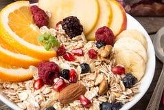 Healthy breakfast. Muesli with orange fruit, apple, pomegranate, Stock Images