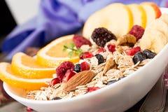 Healthy breakfast. Muesli with orange fruit, apple, pomegranate, Stock Photography