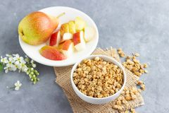 Healthy breakfast with muesli and pear.  royalty free stock photography