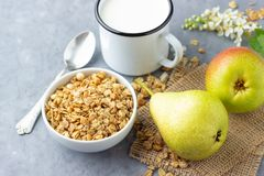 Healthy breakfast with muesli, pear and milk.  stock photos