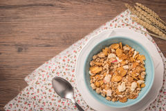 Healthy breakfast with muesli, red apple and cinnamon on rustic Royalty Free Stock Image