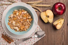Healthy breakfast with muesli, red apple and cinnamon on rustic Royalty Free Stock Photos
