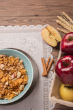 Healthy breakfast with muesli, red apple and cinnamon on rustic Royalty Free Stock Photography