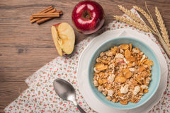Healthy breakfast with muesli, red apple and cinnamon on rustic Stock Photos
