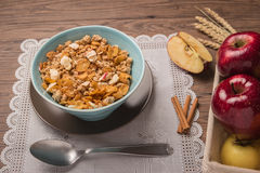 Healthy breakfast with muesli, red apple and cinnamon on rustic. Wooden table. Top view with copy space Royalty Free Stock Photography