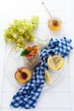 Healthy breakfast: muesli with smoothie, honey, yogurt and fresh berries in a glass jar Royalty Free Stock Photos