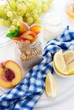 Healthy breakfast: muesli with smoothie, honey, yogurt and fresh berries in a glass jar Royalty Free Stock Image
