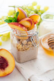 Healthy breakfast: muesli with smoothie, honey, yogurt and fresh berries in a glass jar Stock Photos