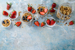 Healthy breakfast of muesli, strawberry. On blue background. Copy space Royalty Free Stock Photo