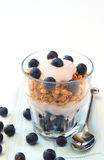 Healthy breakfast with muesli, yogurt and berries. Healthy breakfast with muesli, yogurt and blueberries in a glass Royalty Free Stock Images