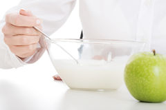 Healthy breakfast, natural yoghurt and apple Stock Images