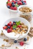 Healthy breakfast with natural yogurt, muesli and berries. Vertical, closeup Royalty Free Stock Images