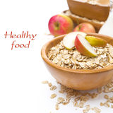 Healthy breakfast - oat flakes with apples in a bowl Royalty Free Stock Images