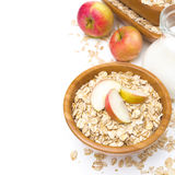 Healthy breakfast - oat flakes with apples and a jug of milk Stock Image