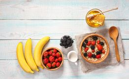Healthy breakfast with oat flakes and  fresh berries on wooden t Royalty Free Stock Image