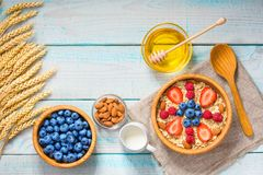 Healthy breakfast with oat flakes and  fresh berries on wooden t Stock Photo