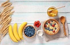 Healthy breakfast with oat flakes and  fresh berries on wooden t Stock Image