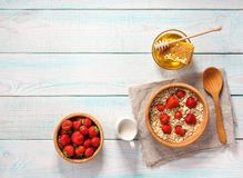 Healthy breakfast with oat flakes, natural milk, fresh strawberr Stock Photography