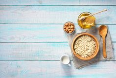 Healthy breakfast with oat flakes, natural milk and honey.  Rust Stock Images