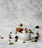 Healthy breakfast with oat flakes, raspberry berries, blueberries, selective focus Royalty Free Stock Photos