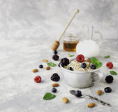 Healthy breakfast with oat flakes, raspberry berries, blueberries, selective focus Royalty Free Stock Photo