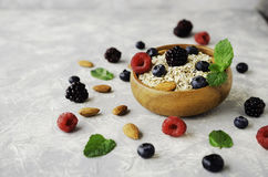 Healthy breakfast with oat flakes, raspberry berries, blueberries, selective focus Stock Photos