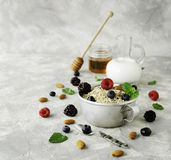 Healthy breakfast with oat flakes, raspberry berries, blueberries, selective focus Stock Photography