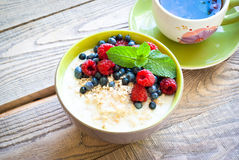 Healthy breakfast - oatmeal with berries Royalty Free Stock Images