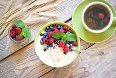 Healthy breakfast - oatmeal with berries Royalty Free Stock Photo