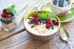 Healthy breakfast - oatmeal with berries Stock Images