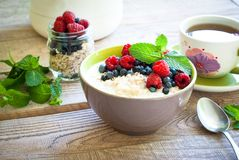Healthy breakfast - oatmeal with berries Stock Photos