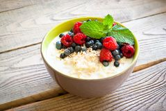 Healthy breakfast - oatmeal with berries Stock Photography