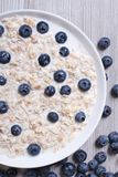 Healthy breakfast of oatmeal with blueberries and milk top view Royalty Free Stock Images