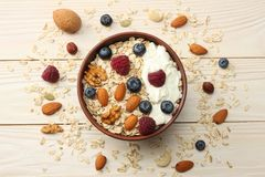 Healthy breakfast. oatmeal, blueberries, raspberries and nuts on white wooden table. Top view with copy space Royalty Free Stock Images