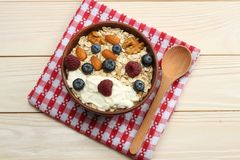 Healthy breakfast. oatmeal, blueberries, raspberries and nuts on white wooden table. Top view with copy space Royalty Free Stock Photos
