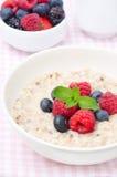 Healthy breakfast - oatmeal with fresh berries Stock Photo