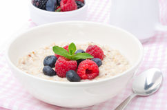 Healthy breakfast - oatmeal with fresh berries, horizontal Royalty Free Stock Images
