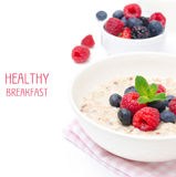 Healthy breakfast - oatmeal with fresh berries isolated on white Stock Photography