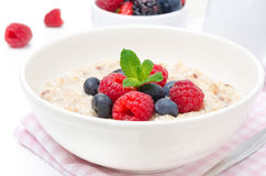 Healthy breakfast - oatmeal with fresh berries isolated on white Stock Image