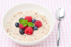 Healthy breakfast - oatmeal with fresh berries, top view Royalty Free Stock Photos