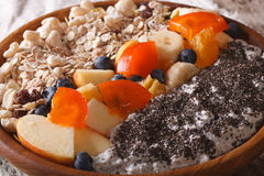 Healthy breakfast: oatmeal with fruit and chia seeds closeup. ho Royalty Free Stock Image