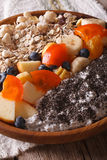 Healthy breakfast: oatmeal with fruit and chia seeds closeup. Ve Royalty Free Stock Photos