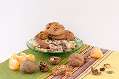 Healthy Breakfast. Of oatmeal, fruit, cinnamon and walnuts cookies on a white background stock images