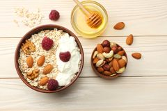 Healthy breakfast. oatmeal, honey and nuts on white wooden table. Top view with copy space Royalty Free Stock Image
