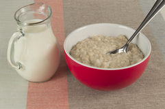 Healthy Breakfast. Oatmeal and milk in glass jug Stock Photos