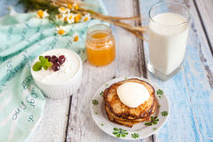 Healthy breakfast with oatmeal pancakes, beaded cheese and milk. Breakfast: oatmeal pancakes with sour cream, beaded cheese with chery jam and milk Stock Images