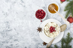 Healthy breakfast oatmeal with pomegranate, bananas, seeds and nuts, overhead scene on white marble. Top view Royalty Free Stock Images