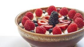Healthy breakfast oatmeal porridge with berries in ceramic bowl. Tasty healthy and breakfast oatmeal porridge with blueberry, raspberry, blackberry, cherry Stock Photos