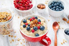 Healthy breakfast, oatmeal porridge with berries and nuts Royalty Free Stock Image